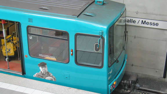 Head of a turquoise subway in the station Festhalle/Messe